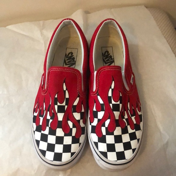 checkerboard slip on vans with red drip